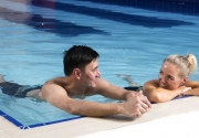 guests-relaxing-in-Clayton-Hotel-Belfast-15m-swimming-pool