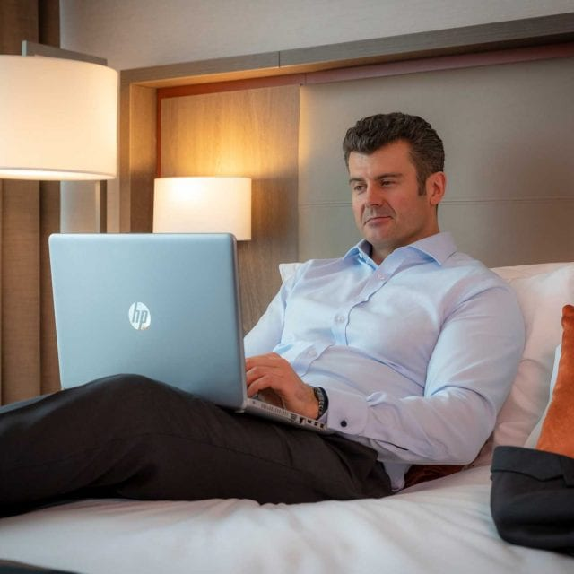 Business guest working in his at Clayton Hotel Executive Room