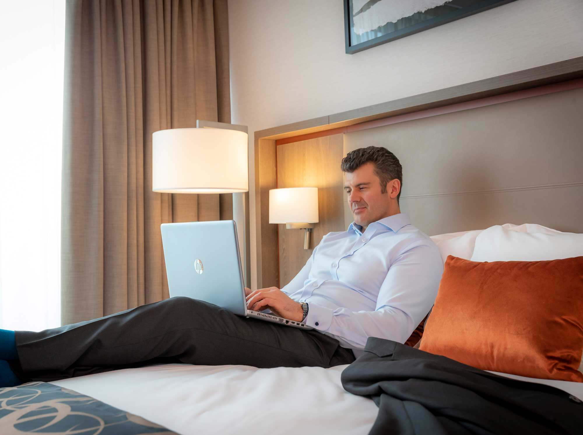 guest-relaxing-in-Clayton-Hotel-Dublin-Airport-room