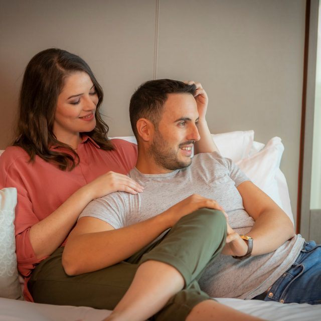 couple on Clayton hotel bed