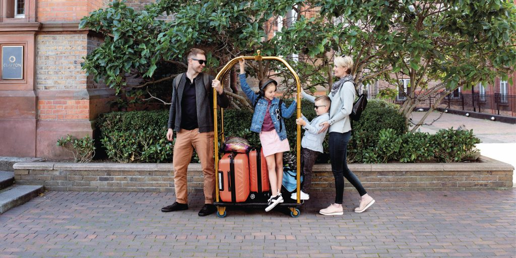 FAMILY pushing a trolley at Clayton hotels