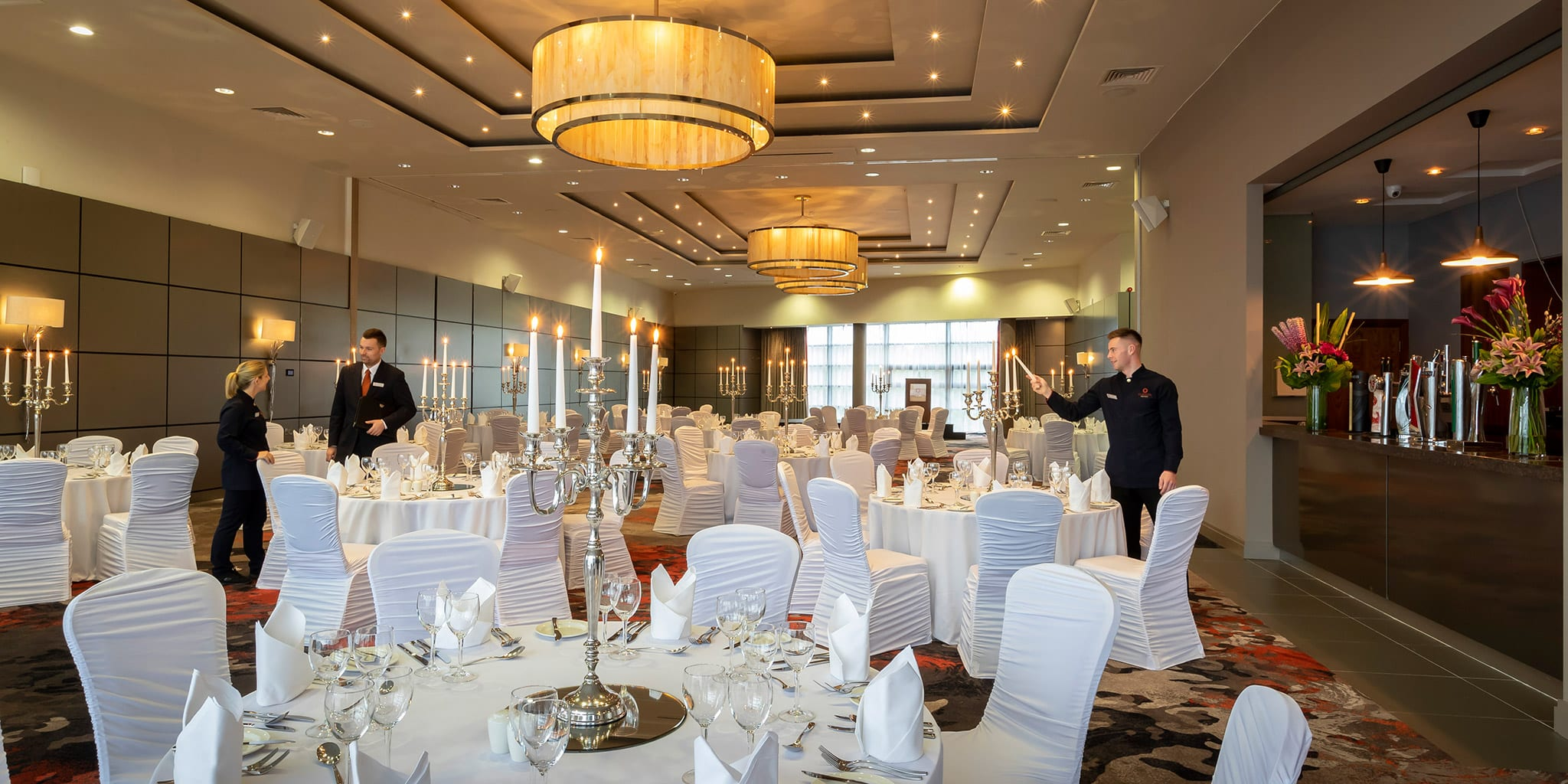 Staff preparing event venue in banquet style