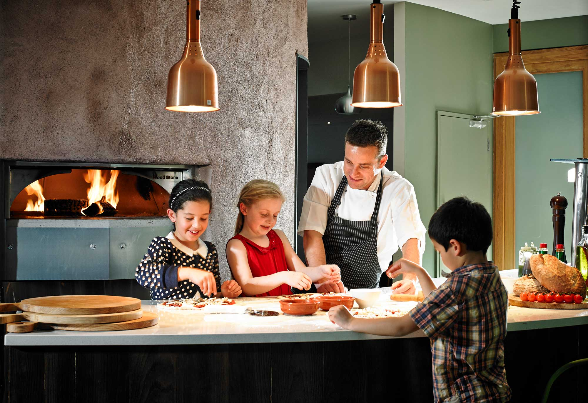 Kids making pizza with Gusto chef at Clayton Hotel Liffey Valley