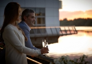 couple-sipping-Champagne-on-Clayton-Hotel-Limericks-balcony-on-banks-of-River-Shannon
