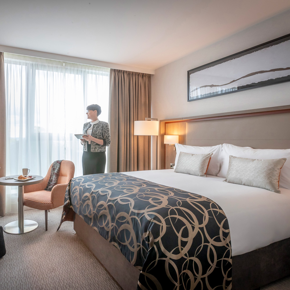 female executive in a clayton hotel bedroom