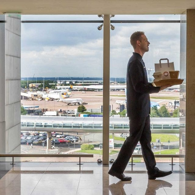 Waiter delivering room service Clayton Hotel Manchester Airport